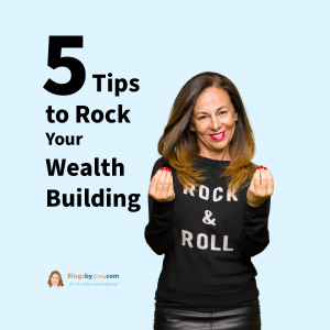 5 Tips to Build Wealth with a middle age woman standing in a rock and roll long sleeve shirt, rubbing her fingers together in the universal money gesture